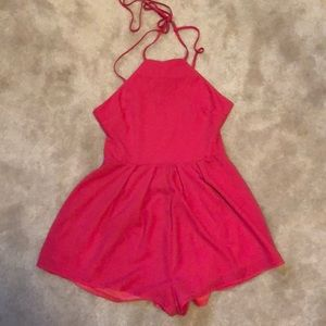 Pink romper with an open back
